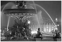 Fountain on Place de la Concorde and Assemblee Nationale by night. Paris, France ( black and white)