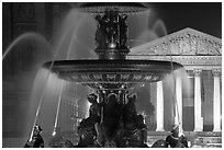 Fountain on Place de la Concorde and Madeleine church at night. Paris, France ( black and white)