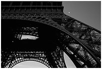 Base of Tour Eiffel (Eiffel Tower) with moon. Paris, France ( black and white)