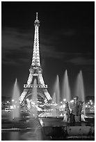 Tour Eiffel (Eiffel Tower) and Fountains on the Palais de Chaillot by night. Paris, France ( black and white)