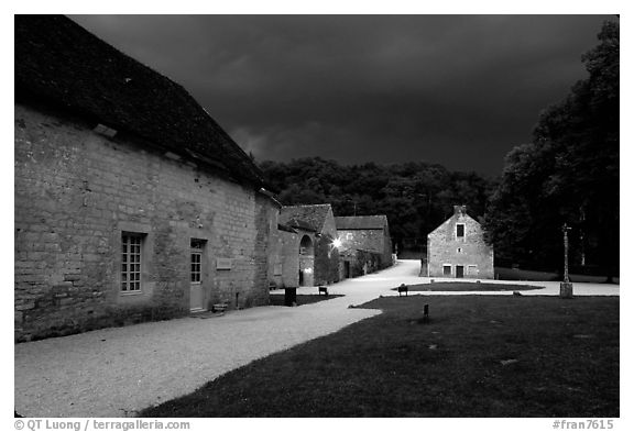 Gardens, approaching evening storm, Fontenay Abbey. Burgundy, France (black and white)