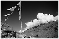 Prayer flag and cloud-capped peak, Himachal Pradesh. India (black and white)