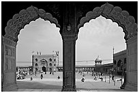 Courtyard of mosque seen through arches of prayer hall, Jama Masjid. New Delhi, India (black and white)
