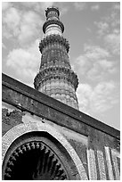 Alai Darweza gate and Qutb Minar tower. New Delhi, India (black and white)