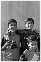 Young boys in front of blue wall. Jodhpur, Rajasthan, India (black and white)