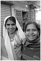 Smiling women in old street. Jodhpur, Rajasthan, India (black and white)