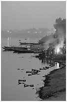Cremation at Harishchandra Ghat at sunset. Varanasi, Uttar Pradesh, India (black and white)