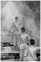 Brahmans standing amongst clouds of incense during puja. Varanasi, Uttar Pradesh, India ( black and white)