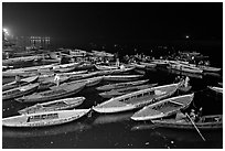 Boats on the Ganges River at night during arti ceremony. Varanasi, Uttar Pradesh, India ( black and white)