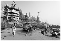 Manikarnika Ghat, with piles of wood used for cremation. Varanasi, Uttar Pradesh, India (black and white)