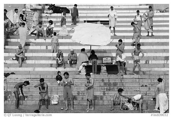 Men after bath on steps of Meer Ghat. Varanasi, Uttar Pradesh, India