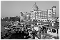 Tour boats and Taj Mahal Palace Hotel. Mumbai, Maharashtra, India ( black and white)