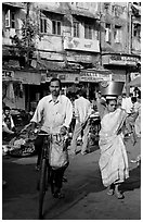 Man riding bike and woman with basket on head, Colaba Market. Mumbai, Maharashtra, India (black and white)