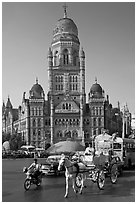 Horse carriage and colonial-area building of Bombay Municipal Corporation. Mumbai, Maharashtra, India ( black and white)