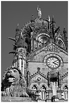 Lion and Gothic tower topped by 4m-high statue of Progress, Victoria Terminus. Mumbai, Maharashtra, India ( black and white)
