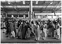Women on train platform, Victoria Terminus. Mumbai, Maharashtra, India ( black and white)