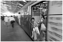 View of departing train with motion blur. Mumbai, Maharashtra, India ( black and white)