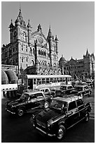 Black and Yellow cabs in front of Victoria Terminus. Mumbai, Maharashtra, India ( black and white)