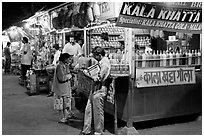 Drinks stall at night, Chowpatty Beach. Mumbai, Maharashtra, India (black and white)