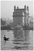 Small boat and Gateway of India, early morning. Mumbai, Maharashtra, India ( black and white)