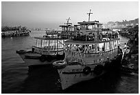 Lighted tour boat at quay,  sunset. Mumbai, Maharashtra, India ( black and white)