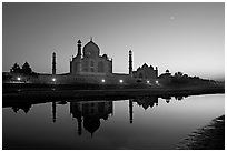 Taj Mahal complex reflected in Yamuna River at sunset. Agra, Uttar Pradesh, India ( black and white)