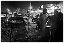 Cycle-rickshaws and vending booths at night, Agra cantonment. Agra, Uttar Pradesh, India (black and white)