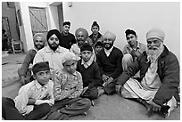 Sikh men and boys in gurdwara. Bharatpur, Rajasthan, India ( black and white)
