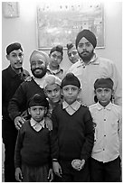 Sikh men and boys in front of picture of the Golden Temple. Bharatpur, Rajasthan, India ( black and white)