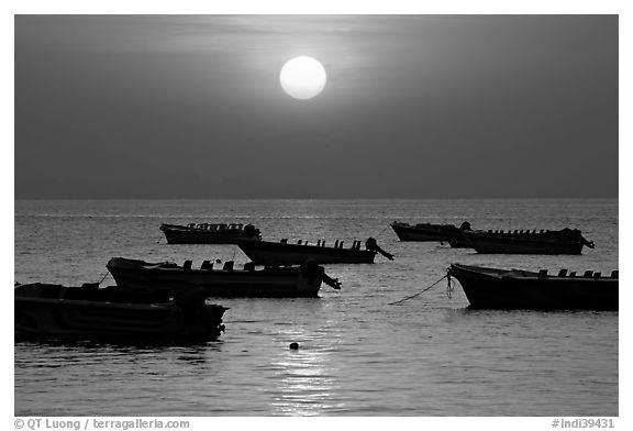 Boats anchored in bay and sunrise, Dona Paula. Goa, India (black and white)