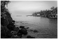 Oceanfront with house and palm trees, Dona Paula. Goa, India ( black and white)