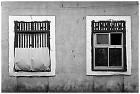 Windows on facade painted blue, Panjim. Goa, India ( black and white)