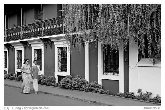 Women strolling past the heritage Panaji Inn, Panjim. Goa, India (black and white)