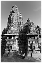 Lakshmana temple seen from Matangesvara temple, with people looking. Khajuraho, Madhya Pradesh, India (black and white)