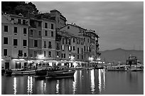 Houses reflected in harbor at dusk, Portofino. Liguria, Italy ( black and white)