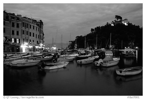 Harbor and San Giorgio castle at dusk, Portofino. Liguria, Italy