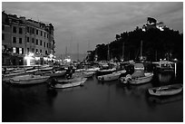 Harbor and San Giorgio castle at dusk, Portofino. Liguria, Italy ( black and white)
