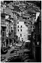 Plazza with parked boats built along steep ravine, Riomaggiore. Cinque Terre, Liguria, Italy (black and white)