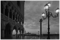 Lamp, column with Lion, Piazza San Marco (Square Saint Mark) at dawn. Venice, Veneto, Italy ( black and white)