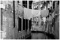 Clothelines and canal in a popular quarter, Castello. Venice, Veneto, Italy ( black and white)