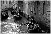 Several gondolas in a narrow canal. Venice, Veneto, Italy ( black and white)