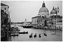 Gondolas, Grand Canal, Santa Maria della Salute church from the Academy Bridge, dusk. Venice, Veneto, Italy ( black and white)