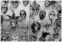 Carnival masks over golden background, Burano. Venice, Veneto, Italy ( black and white)