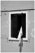 Laundry hanging from a window, Burano. Venice, Veneto, Italy ( black and white)