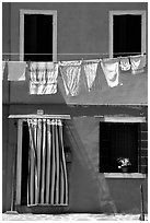Hanging laundry and colored wall, Burano. Venice, Veneto, Italy ( black and white)