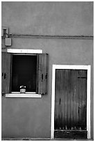 Door, window, pink-colored house,  Burano. Venice, Veneto, Italy ( black and white)
