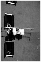 Windows, hanging laundry, blue house, Burano. Venice, Veneto, Italy ( black and white)