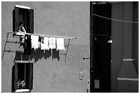 Woman hangs laundry to dry, Burano. Venice, Veneto, Italy ( black and white)