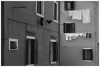 Multicolored houses and hanging laundry, Burano. Venice, Veneto, Italy ( black and white)