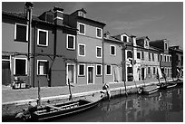 Canal bordered by colorfully painted houses, Burano. Venice, Veneto, Italy ( black and white)